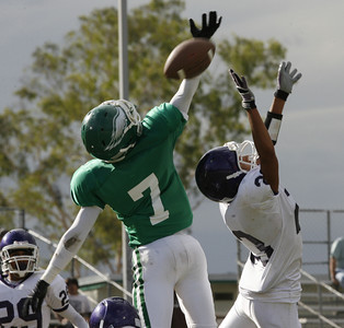 Eagle Rock's  Sebastian Bowers goes up for a pass against Bell's Esteban Mendo during the second quarter on Friday, September 21, 2007 at Eagle Rock High School (Edna T. Simpson)