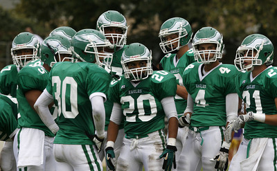 Eagle Rock's players stand in a huddle waiting for instructions from their coach on the sideline during the game on Friday, September 21, 2007 against Bell High Schoo. Eagle Rock won 28-0 (Edna T. Simpson)
