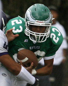 Eagle Rocks' Freddy Reyes gains yardage during the game on Friday, September 21, 2007 against Bell High School. Eagle Rock won 28-0 (Edna T. Simpson)