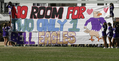 Bell cheerleaders hold up a sign for the football players  to break through at the beginning of second half  on Friday, September 21, 2007 against Eagle Rock at Eagle Rock High School. (Edna T. Simpson)