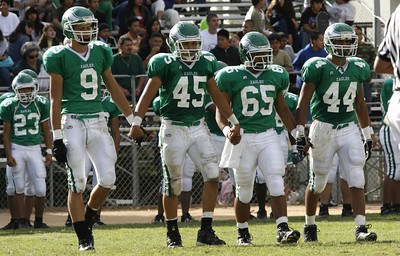 Eagle Rock captains walks onto the field at the beginning of second half of the victory game against Bell High School.  Eagle Rock won 28-0 (Edna T. Simpson)