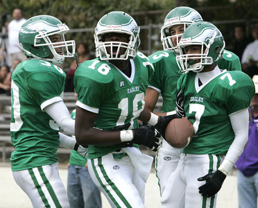 Eagle Rock Andre Lyons celebrates with his teammates after completing a touchdown during the second  half of the game on Friday, September 21, 2007 against Bell High School. (Edna T. Simpson)
