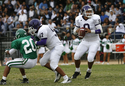 Bell's QB Francisco Rodriguez looks down the field  to throw the ball to a receiver during the second quarter of the game against Eagle Rock on Friday, September  21, 2007  (Edna T. Simpson)
