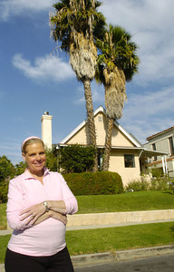 Debbi Steinfeld in front of her home in Los Angeles built in 1919 and does not have earthquake insurance on her home in the mid Wilshire area.  (Tina Burch/Staff Photographer)