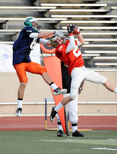 (L) West team player #8 Richard Mullaney gets ball intercepted by East team player #25 Kevin Ervin and gives him a full face mask,  as the East took the win 21-20 over the West  during the 15th annual Daily News East-West all-star football game at Collage of the Canyons in Valencia CA. Jan 16, 2011 Photo by Gene Blevins/LA Daily news