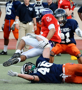 East team player #21 Max Rodriguez gets knocks off his feet by West team player #46 Alex Singleton, as the East took the win 21-20 over the West  during the 15th annual Daily News East-West all-star football game at Collage of the Canyons in Valencia CA. Jan 16, 2011 Photo by Gene Blevins/LA Daily news