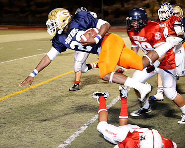 West team player #23 Jonathon Williams gets knock airborne running down the sidelines,  as the East took the win 21-20 over the West  during the 15th annual Daily News East-West all-star football game at Collage of the Canyons in Valencia CA. Jan 16, 2011 Photo by Gene Blevins/LA Daily news