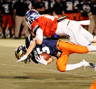 West team player #85 Joshuah Guzman  gets knock airborne by East team player #44 Ryan Seidler,  as the East took the win 21-20 over the West  during the 15th annual Daily News East-West all-star football game at Collage of the Canyons in Valencia CA. Jan 16, 2011 Photo by Gene Blevins/LA Daily news