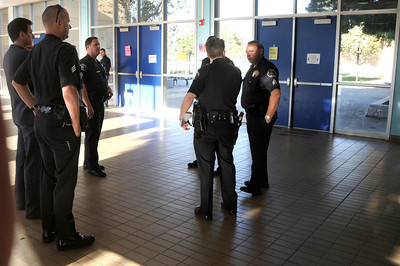 Los Angeles Police officers stand in the foyer outside the school offices while responding to El Camino Real High School today after reports circulated that an individual was making threats with a gun. Officers did not recover a firearm, and the campus was locked down for a short period of time. Woodland Hills ,CA 1-26-2011. (John McCoy/staff photographer)
