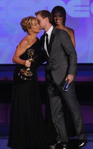 Neil Patrick Harris  kisses Edie Falco on the check after she won the Emmy for Outstanding Lead Actress in a Comedy Series at the 62nd Primetime Emmy Awards on Sunday, August  29, 2010, at the Nokia Theatre in Los Angeles.(Michael Owen Baker/ staff photographer)