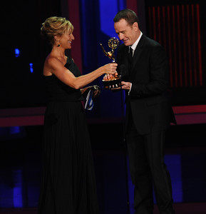 Edie Falcom present Bryan Cranston who won an Emmy Award for Outstanding Lead Actor In A Drama Series for his role on 'Breaking Bad' at the 62nd Primetime Emmy Awards on Sunday, August  29, 2010, at the Nokia Theatre in Los Angeles.(Michael Owen Baker/ staff photographer)