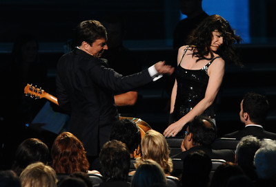 Jimmy Fallon fake slaps Julianna Margulies at the 62nd Primetime Emmy Awards on Sunday, August  29, 2010, at the Nokia Theatre in Los Angeles.(Michael Owen Baker/ staff photographer)