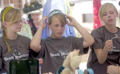 Chatsworth-Elyse Wood, left, Mackenzie Seibert, and Sarah Olson try out head bands during the End of Spring Music Festival Saturday June 2, 2007 in Chatsworth. Other types of music included country, classic rock, alternative , and gospel soul. Arts and crafts, prizes, games, and barbeque were some of the activities.(Joe Binoya/Special to the Daily News)