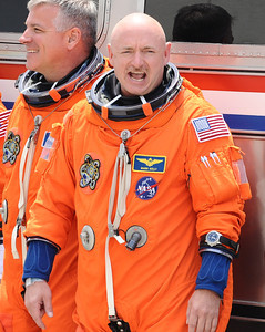 Commander Mark Kelly, who is to lead space shuttle Endeavour's STS-134 mission, waves as he walks out of crew quarters shortly before the scheduled launch was scrubbed for at least three days Kennedy Space Center FL. April 28,2011. Photo by Gene Blevins/LA Daily News