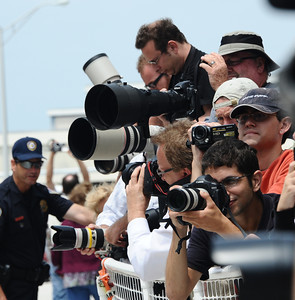 News photographers take photos of Endeavour crew as they walk out on the way to the launch pad. Problems with the shuttle Endeavour's hydraulic power system forced NASA managers to scrub Friday's planned launch on a space station assembly mission, disappointing thousands of spectators and spoiling a visit by President Obama and his family.  Kennedy Space Center FL. April 28,2011. Photo by Gene Blevins/LA Daily News