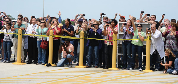 KSC workers take photos as Endeavour crew walks on the way to the launch pad. Problems with the shuttle Endeavour's hydraulic power system forced NASA managers to scrub Friday's planned launch on a space station assembly mission, disappointing thousands of spectators and spoiling a visit by President Obama and his family.  Kennedy Space Center FL. April 28,2011. Photo by Gene Blevins/LA Daily News