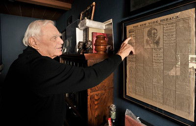 Ernest Borgnine looks at a copy of The New York Herald that talks about the Lincoln assasination in a copy dated Saturday, April 15, 1865. Borgnine will be honored with a Screen Actors Guild Lifetime Acheivement Award on January 30. Beverly Hills, CA 1-21-2011. (John McCoy/staff photographer)