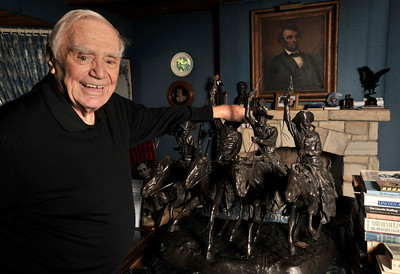 """Ernest Borgnine looks at the Remington statue he keeps in his """"Lincoln Room.""""  will be honored with a Screen Actors Guild Lifetime Acheivement Award on January 30. Beverly Hills, CA 1-21-2011. (John McCoy/staff photographer)"""