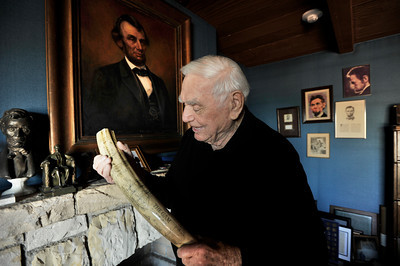 """Ernest Borgnine with a scrimshaw that he keeps in his """"Lincoln"""" room. Borgnine will be honored with a Screen Actors Guild Lifetime Acheivement Award on January 30. Beverly Hills, CA 1-21-2011. (John McCoy/staff photographer)"""