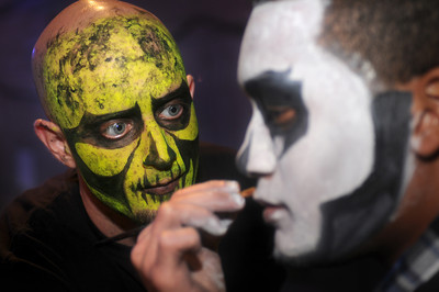 """(l-r) Makeup artist Simpat Beshirian,30 of Burbank, puts a """"Reaper"""" face on Todd Putman,21 of Fort Worth Texas.Thousands of fans of the video game Call of Duty descended on the Stags at Playa Vista to experience the release of a new version of the game. Hundreds of monitors where available for people to try out the new game. In addition, attendees could also experience real-life Call of Duty thrills, including paintballing in a recreated, life-size Call of Duty map, Sumo wrestle or go for a ride on a zip line. Playa Vista, CA. 9-3-2011. (John McCoy/Staff Photographer)"""