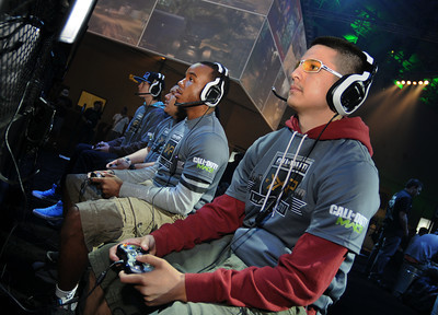 (l-r) Phillip Klemenov,19, Francisco Vega,18,Troy Gilliam,19, and Christian Raymundo,21, all from the Bay area, team up during a competition where they were in line for a $400,000 payday. Thousands of fans of the video game Call of Duty descended on the Stags at Playa Vista to experience the release of a new version of the game. Hundreds of monitors where available for people to try out the new game. In addition, attendees could also experience real-life Call of Duty thrills, including paintballing in a recreated, life-size Call of Duty map, Sumo wrestle or go for a ride on a zip line. Playa Vista, CA. 9-3-2011. (John McCoy/Staff Photographer)