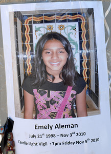 A photo of Emely taped to a light pole at the curbside memorial.  Officials and North Hollywood residents demand the installation of a traffic signal at a busy intersection where a 12-year-old girl was hit by an SUV and later died.  Emely Aleman, 12, was taken off life support Thursday and Angela Rodriguez, 10, who was also struck in the Tuesday incident, remained hospitalized with critical injuries as a result of their being hit by a Jeep Wrangler while they were in a crosswalk at Laurel Canyon Boulevard and Archwood Street.  (Dean Musgrove/Staff Photographer)