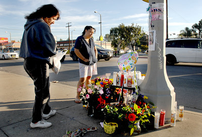 Jacqueline Dobbs and Sonia Rivera visit the curbside memorial.  Both mothers were very upset about the accident that took Emely's life.  Officials and North Hollywood residents demand the installation of a traffic signal at a busy intersection where a 12-year-old girl was hit by an SUV and later died.  Emely Aleman, 12, was taken off life support Thursday and Angela Rodriguez, 10, who was also struck in the Tuesday incident, remained hospitalized with critical injuries as a result of their being hit by a Jeep Wrangler while they were in a crosswalk at Laurel Canyon Boulevard and Archwood Street.  (Dean Musgrove/Staff Photographer)