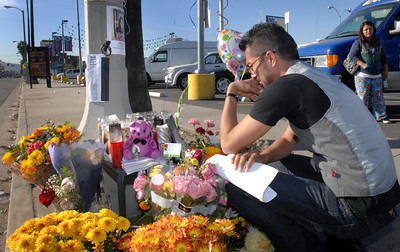 Gabriel Avila, uncle and godfather of the victim, Emely, weeps at the street memorial erected in her memory.  Officials and North Hollywood residents demand the installation of a traffic signal at a busy intersection where a 12-year-old girl was hit by an SUV and later died.  Emely Aleman, 12, was taken off life support Thursday and Angela Rodriguez, 10, who was also struck in the Tuesday incident, remained hospitalized with critical injuries as a result of their being hit by a Jeep Wrangler while they were in a crosswalk at Laurel Canyon Boulevard and Archwood Street.  (Dean Musgrove/Staff Photographer)