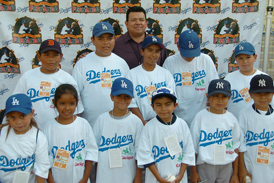 """Fernando Valenzuela meets his young fans who are part of his """"Los Amigos de Fernando."""" The former Dodger pitching ace entertained 38 kids by inviting them down to the field to sign autographs and pose for pictures behind home plate before a game against the Atlanta Braves. Photo taken in Los Angeles , California 7-5-2007.  photo by John McCoy/LA Daily News"""
