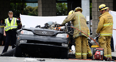 """on the scene of a crash were one motorist was killed early today in a fiery three-vehicle crash in the 10300 block of Reseda Blvd. A SUV caught fire after being hit from Mercedes Benz that was going a high rate of speed about 7:30 a.m. near Reseda and Devonshire St.  """"Despite the quick response of Los Angeles firefighters, one occupant of the SUV was declared deceased at the scene. June 21,2010. Photo by Gene Blevins/LA Daily News"""