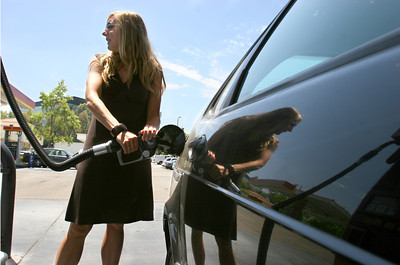 Jennifer Repo fills up her Saab at a Thrifty gas station in Woodland Hills, Ca. July 24, 2007. (Michael Owen Baker, Los Angeles Daily News)