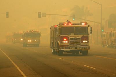 MALIBU FIRE--Fire trucks move along Pacific Coast Highway sunday to battle flames.  Photo by David Crane/Staff Photographer.