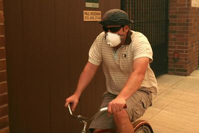 MALIBU FIRE--A man wears a mask as he rides along Pacific Coast Highway sunday.  Photo by David Crane/Staff Photographer.