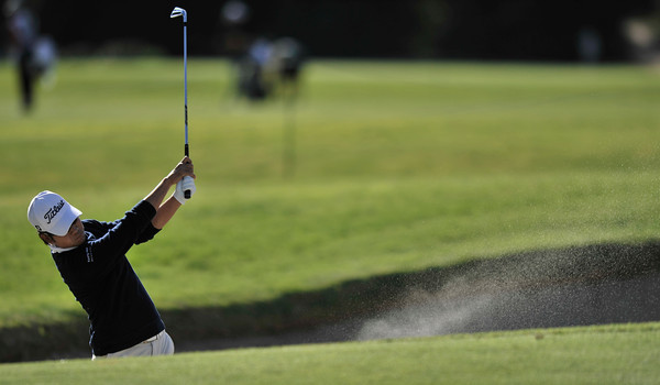 Kevin Na hits out of the bunker on the 9th fairway. For a time he was tied with the leaders at 4 under during the first round of the Northern Trust Open at Riviera Country Club in Pacific Palisades , CA. 2-17-2011. (John McCoy/staff photographer)