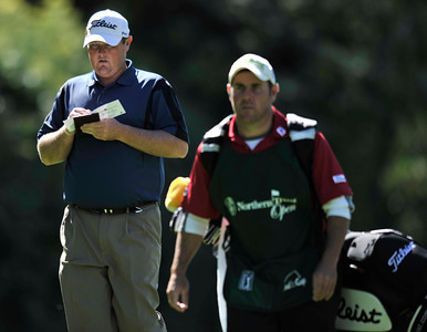 Jarrod Lyle checks his score card on his way to the 12th tee box during the first round of the Northern Trust Open at Riviera Country Club in Pacific Palisades , CA. 2-17-2011. (John McCoy/staff photographer)