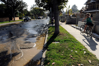Flooding caused street damage in the 4400 block of Forman Ave in Toluca Lake Wednesday, November 30, 2011. (Hans Gutknecht/Staff Photographer)