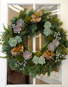 Succulents are the punctuation mark that make this wreath. Mark Held has designed a variety of floral arrangements for the holidays at Mark's Garden, located on Ventura Blvd. in Sherman Oaks, CA 12/08/2011(John McCoy/Staff Photographer)