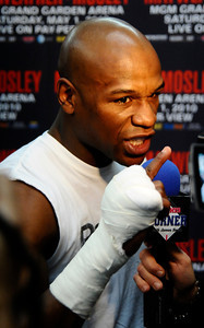 Floyd Mayweather Jr. sean here back on April 14,2010 at his gym in Las Vegas NV.  Boxer Floyd Mayweather Jr. has been arrested in Las Vegas on a felony theft charge stemming from a domestic violence complaint by his ex-girlfriend Josie Harris.  Police say the 33-year-old boxer was booked Friday at the Clark County Detention Center on a grand larceny charge. He's being held on $3,000 bail.  Mayweather's lawyer, Richard Wright, says the charge stems from an allegation that Mayweather took an iPhone from Josie Harris, his ex-girlfriend and mother of three of his children.  Harris made a police complaint and sought a protection order Thursday from a Family Court judge. Las Vegas NV. Photo by Gene Blevins/LA DailyNews