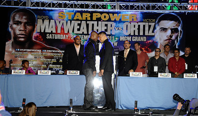 (L) Floyd Mayweather Jr. faces off with Victor Ortiz at the Nokia center during a press conference on their upcoming fight on Sept 17th at the MGM grand hotel in Las Vegas for the WBC welterweight title. Los Angeles CA. June 29,2011. photo by Gene Blevins/LA Daily News