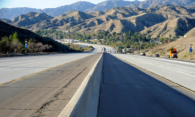 View of the east and west bound lanes of the 210 freeway at Sunland Blvd. after the roadway had been closed. Traffic on the 210 freeway came to a stand still during the evening rush hour. A massive man hunt was underway in the area of the 118 and 210 junction after a parol officer was shot and wounded. Sunland, CA 1/4/2012(John McCoy/Staff Photographer)