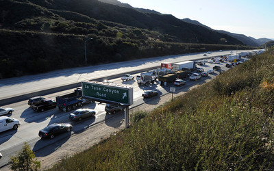 Traffic on the west bound 210 freeway at La Tuna Canyon came to a stand still during the evening rush hour. A massive man hunt was underway in the area of the 118 and 210 junction after a parol officer was shot and wounded. Sunland, CA 1/4/2012(John McCoy/Staff Photographer)