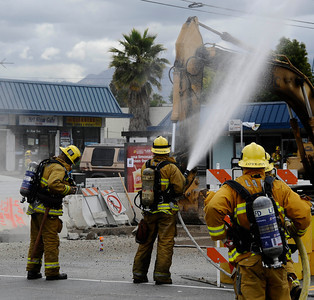 LA city firefighters and gas compnay crews on scene of a natural gas line brake after some evacuations today in sending up a dust cloud. Firefighters were sent to the 6800 block of North Coldwater Canyon Avenue shortly after 10 a.m. and nearby business were evacuated until the break could be fix in several hours. June 6,2011. Photo by Gene Blevins/LA DailyNews