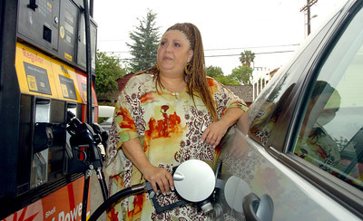 Tata Vega, 55, of Sherman Oaks, gases up at the Shell Station at the corner of Van Nuys Blvd and Moorpark Street on Monday, May 21, 2007 in Sherman Oaks, Ca.  (Tina Burch/Staff Photographer)