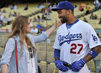 Emily Tweed talks with Matt Kemp before Gene Simmons threw out the first pitch in a Dodger game vs the New York Mets. The Dodgers lost to the Mets 6-0 in a game played at Dodger Stadium in Los Angeles, Ca 7-5-2011. (John McCoy/Staff Photographer)