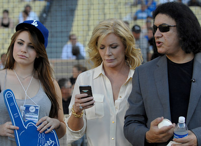 (l-r) Sophie Simmons, Shannon Tweed and Gene Simmons are seen on the field before Gene threw out the first pitch in a Dodger game vs the New York Mets. The Dodgers lost to the Mets 6-0 in a game played at Dodger Stadium in Los Angeles, Ca 7-5-2011. (John McCoy/Staff Photographer)