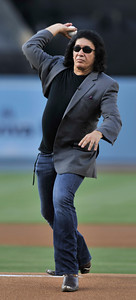 Gene Simmons throws out the first pitch in a Dodger game vs the New York Mets. The Dodgers lost to the Mets 6-0 in a game played at Dodger Stadium in Los Angeles, Ca 7-5-2011. (John McCoy/Staff Photographer)