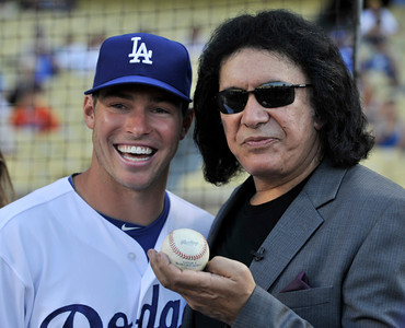Trent Oeltjen and Gene Simmons. Simmons threw out the first pitch before a Dodger game vs the New York Mets. The Dodgers lost to the Mets 6-0 in a game played at Dodger Stadium in Los Angeles, Ca 7-5-2011. (John McCoy/Staff Photographer)