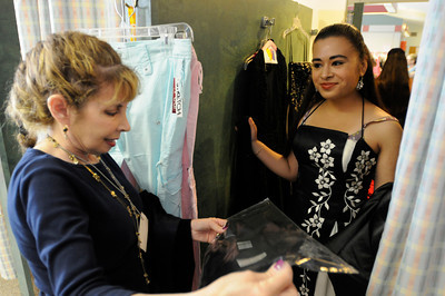"""For the fourth consecutive year, the Los Angeles Unified School District (LAUSD) Homeless Education Branch will partnered with Operation School Bell to fulfill 38 teenage girls' dream of wearing the perfect dress on prom night. The lucky girls, identified as either homeless or from low-income families, have been chosen from throughout the District to select """"the"""" dress from a closet filled with formals, after-five, evening attire and party dresses ranging in sizes from 0 to 16. The fantasy closet features dresses designed in an array of colors and styles, including full-length, mini, satin, lace and strapless creations. Shoes and accessories will also be provided to complete their ensemble and prom dream. Hollywood, CA 5-6-2011. (John McCoy/staff photographer)"""