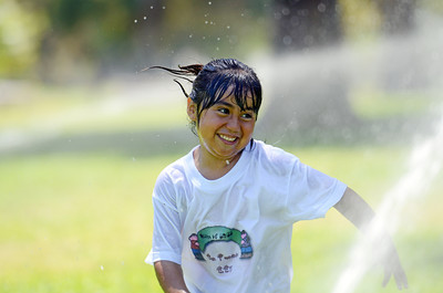 Gisabelle Gonzalez, 5-years-old, plays in the sprinklers at El Cariso Park in Sylmar Tuesday, August 23, 2011. (Hans Gutknecht/Staff Photographer)