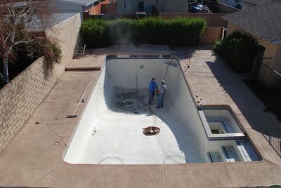 Workers prepare to remove the pool in Phil and Cil Rivera's Granada Hills backyard.
